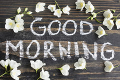 Words Good Morning with Jasmine Flowers. On Rustic Wooden Background stock photos