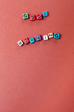 The words good morning spelled out in beads on brown background Royalty Free Stock Images