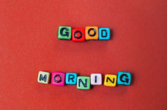 Words good morning spelled out in colorful cube beads Royalty Free Stock Image