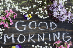 Words Good Morning with Spring Flowers. On a Rustic Wooden Background royalty free stock photography