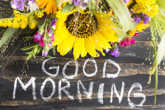 Words Good Morning with Summer Flowers on a Rustic Wooden Backgr. Ound Stock Image