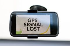 GPS Signal Lost type on a GPS smart phone. The words GPS Signal Lost type on a smart phone GPS navigation screen mounted on a windshield royalty free stock photography