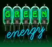 Words GREEN enregy made with glowing letters. Words GREEN energy made with a row of color vacuum tubes with glowing letters inside  on black background Royalty Free Stock Photography