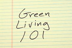 Green Living 101 On A Yellow Legal Pad Stock Image