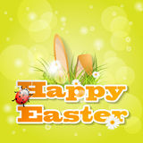 Words Happy Easter with grass and ears of bunny Royalty Free Stock Photos