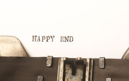 Words happy end  written on typewriter Royalty Free Stock Photos