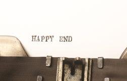 Words happy end  written on typewriter Royalty Free Stock Photos
