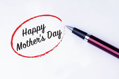The words Happy Mother's Day written in a red circle with a pen royalty free stock photo