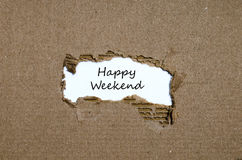 The words happy weekend appearing behind torn paper Stock Image