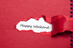 The words happy weekend appearing behind torn paper Stock Photos