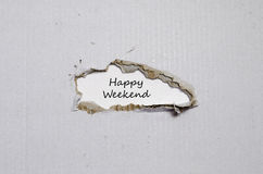 The words happy weekend appearing behind torn paper Royalty Free Stock Photos