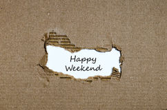The words happy weekend appearing behind torn paper Royalty Free Stock Image