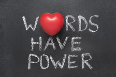Words have power heart. Words have power phrase handwritten on blackboard with heart symbol instead of O stock image