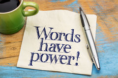 Words have power - napkin note or reminder. Words have power - handwriting on a napkin with cup of coffee against grunge wood royalty free stock images