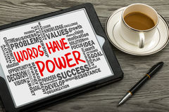 Words have power with related word cloud hand drawing on tablet Royalty Free Stock Photo