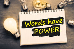 Words Have Power. Text on notebook with glowing light bulb Stock Images