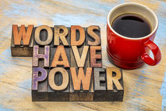 Words have power in wood type. Words have power  phrase in vintage letterpress wood type printing blocks stained by color inks with a cup of coffee Royalty Free Stock Image