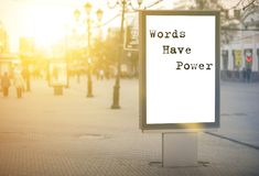 Words have power - words, phrase. On a white background billboard in the center of the city against sun rays royalty free stock photos