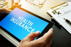 Words Health insurance on a screen. Royalty Free Stock Photo