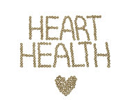The words heart health spelled out in cheerios. On a white background Royalty Free Stock Images