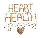 The words Heart Health spelled out in cheerios. On a white background Stock Photography