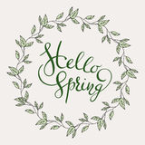 Words Hello Spring with leaves wreath Stock Image