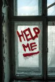 Words Help Me written on old window by blood or red paint. Depression and despair concept.  stock photos