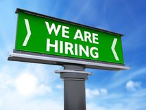 We are hiring. The words we are hiring in a large billboard Royalty Free Stock Photos