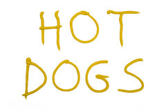 Words HOT DOGS written with mustard Stock Images