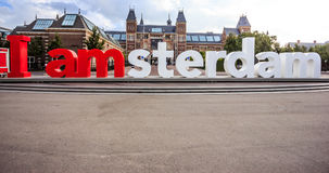 The words `I amsterdam` in front of The Rijksmuseum Netherlands national museum with space below. Stock Photos