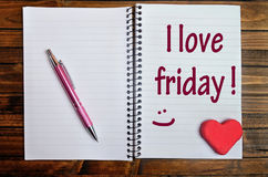 The words I love friday on notebook Stock Image