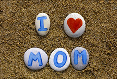Words I love mom spell out from stones with letters Royalty Free Stock Photography
