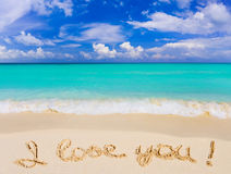 Words I Love You on beach stock image