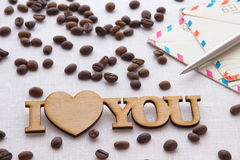The words`I love you`, envelope, pen, spilled coffee on white background. The words `I love you` and envelope,  spilled coffee on white background Royalty Free Stock Photo