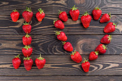 Words i love you lettered with fresh organic strawberry. Words i love you lettered with fresh organic strawberry isolated on wooden background. Love Confession Royalty Free Stock Photography