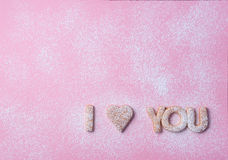 Words - I love you 2. Words I love you  made of cookies placed on a pink paper surface with a icing sugar poured over Stock Photography