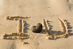 Words I Love You writed on sand beach Royalty Free Stock Images