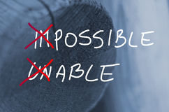 Words impossible unable concept handwritten on wooden log background Stock Images