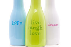 Words of Inspiration. Inspirational Words Ceramic Bottles on White for inspirational purposes and abstract presentation Stock Image