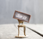 The words JOIN US and chair. Job recruiting. Stock Image