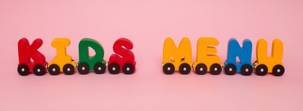 Words kids menu made of letters train cars alphabet. Bright colors of red yellow green and blue on a white background. Early child. Words kids menu made of stock photography