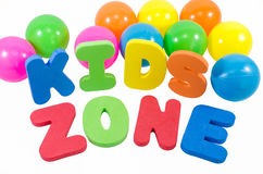 The words kids zone with balls Stock Photography
