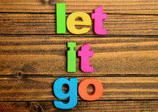 Words Let it go on table Royalty Free Stock Photos
