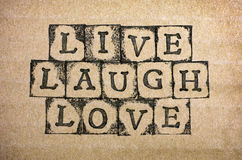Words Live, Laugh, Love make by black alphabet stamps Royalty Free Stock Images