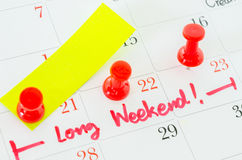 The words Long Weekend written on a white calendar. Royalty Free Stock Photo