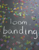 The words loom banding on blackboard with elastics Stock Photo