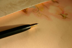 Words of love. Romantic (perfumed) letter paper and elegant ballpoint-pen stock images