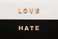 Words Love and Hate on contrast background. Opposite feelings, strong emotions concept royalty free stock photos