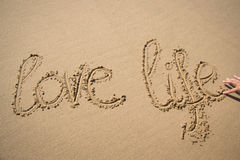 The words love life written in the sand Royalty Free Stock Image