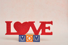 The words love mom spelled with alphabet blocks Royalty Free Stock Photos
